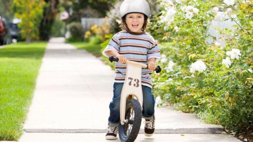 Balance bike being ridden by toddler.