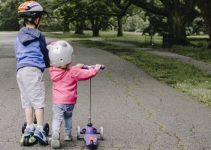 Boy and girl with kick scooters