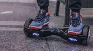 boys feet standing on a hoverboard