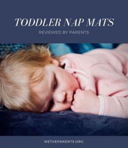 A toddler naps on a mat