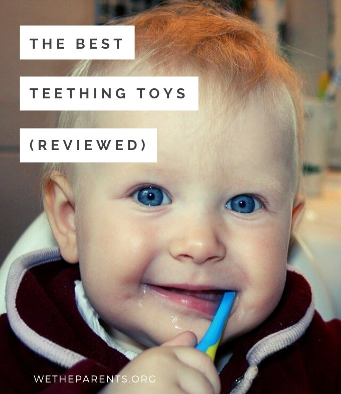 Baby chews on teething toy